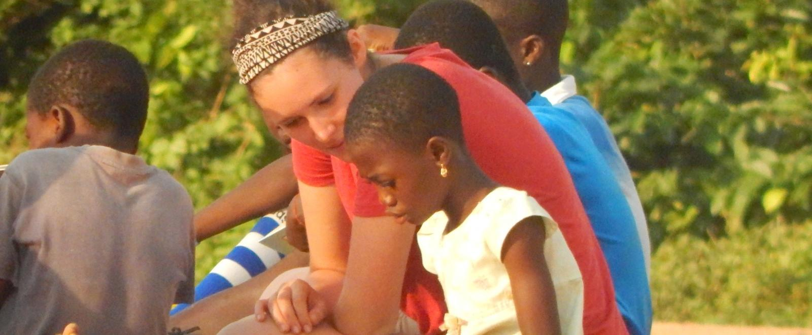 A Projects Abroad intern gains social work experience in Ghana by working through activities with a child.